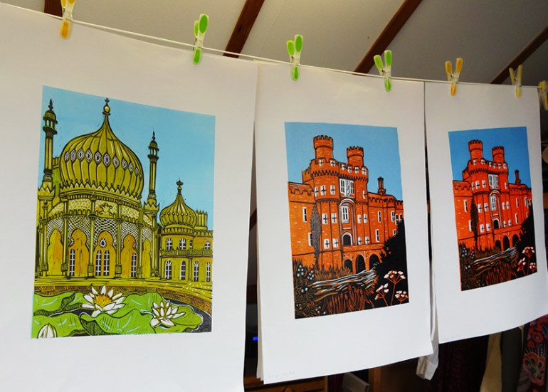prints on paper drying on an indoor washing line