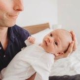 newborn baby boy looking at dad