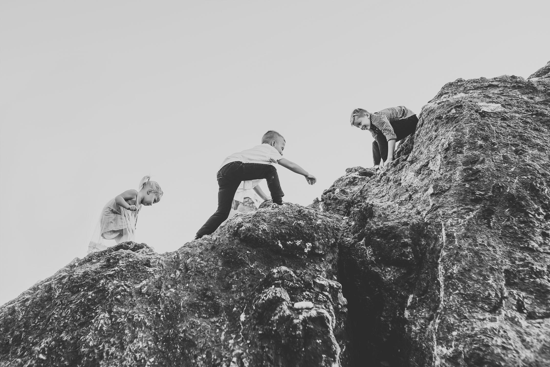 kids climbing rocks at ruby beach washington