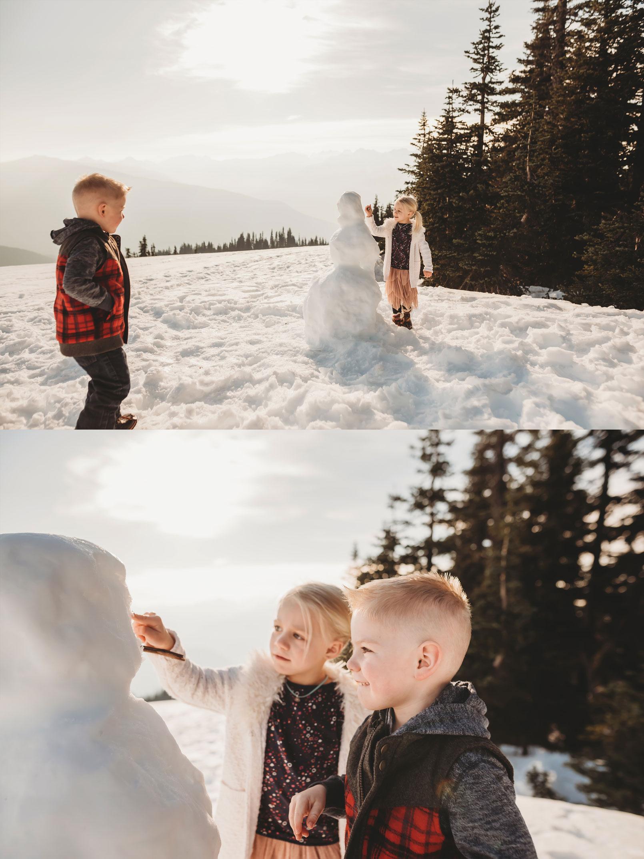 kids build a snowman at Hurricane Ridge