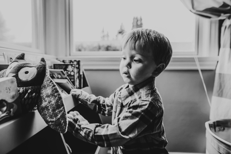 little boy doing art