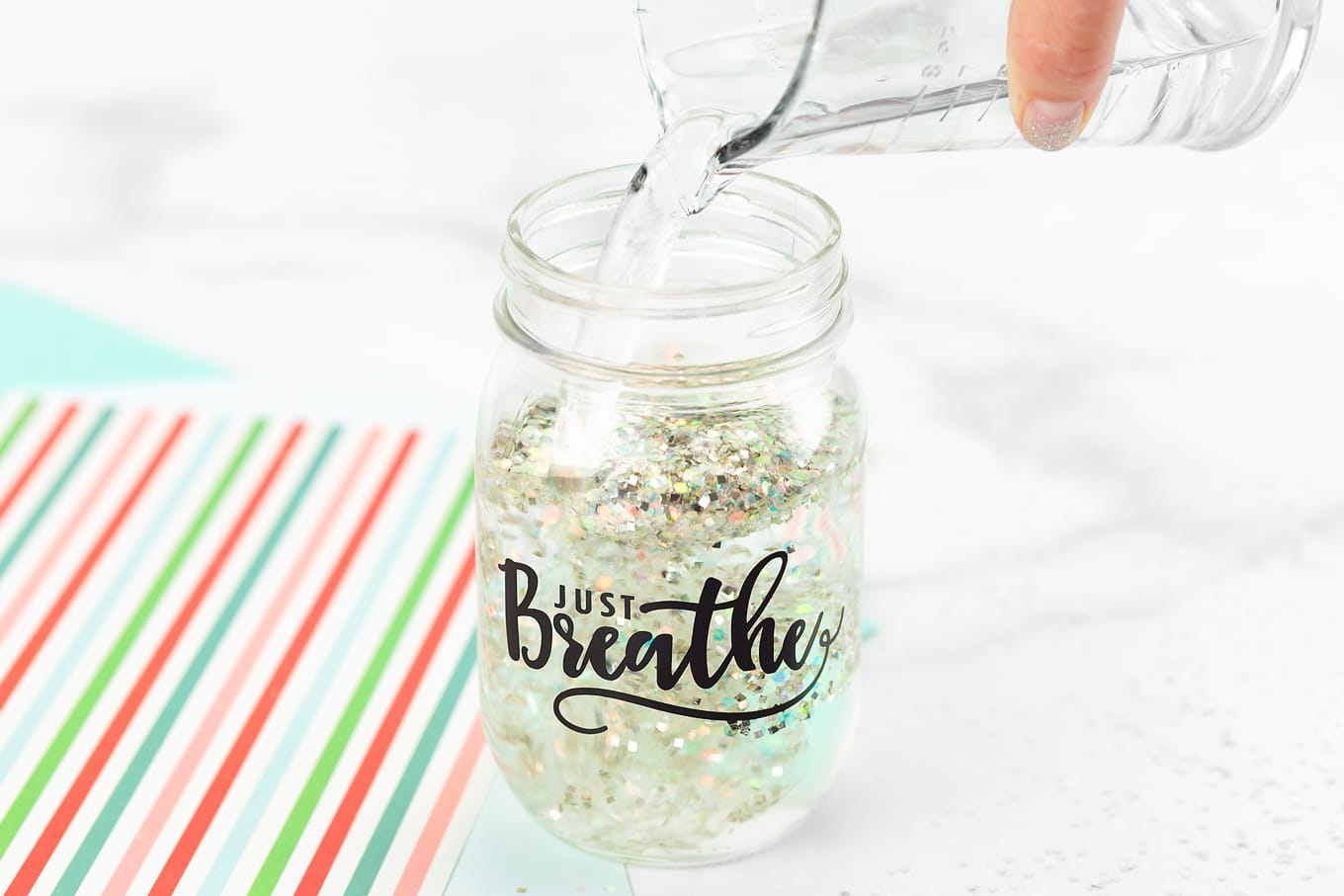 Pouring Water into Glitter Jar