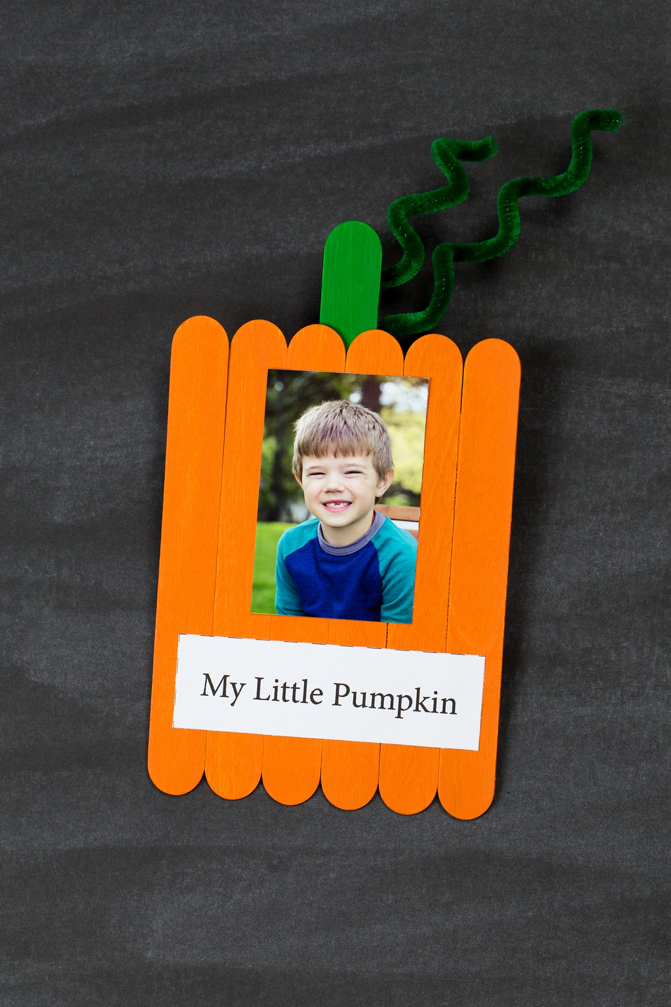 Fun and easy Popsicle stick pumpkin keepsake with photo