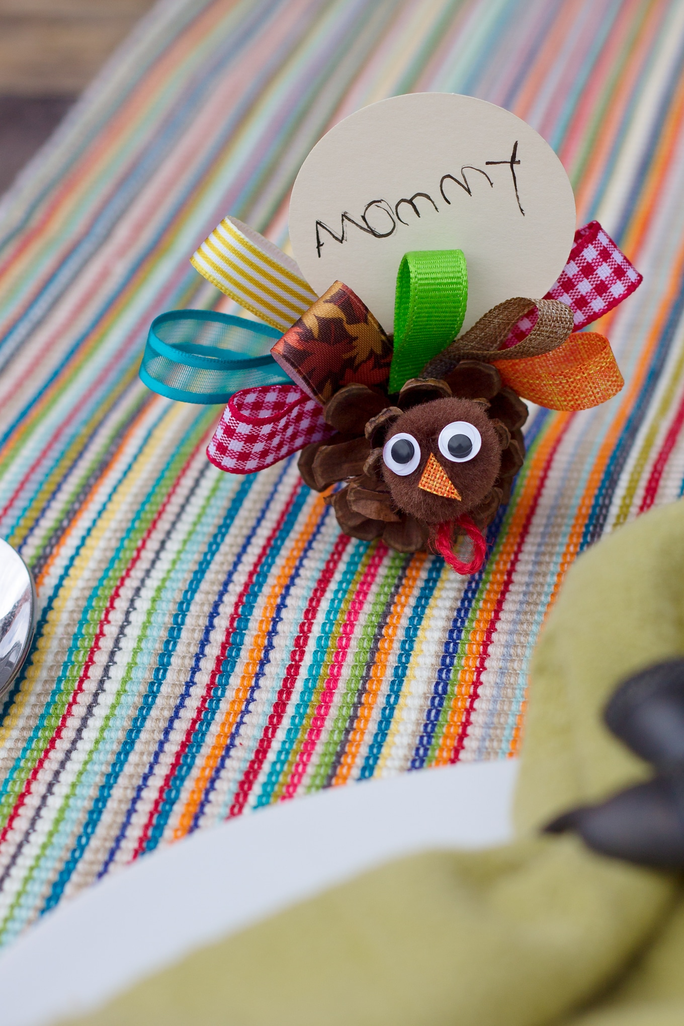 Just in time for Thanksgiving, learn how to make Scrap Ribbon Pine Cone Turkeys from ribbon, pine cones, and pom poms. It's the perfect nature craft for kids!