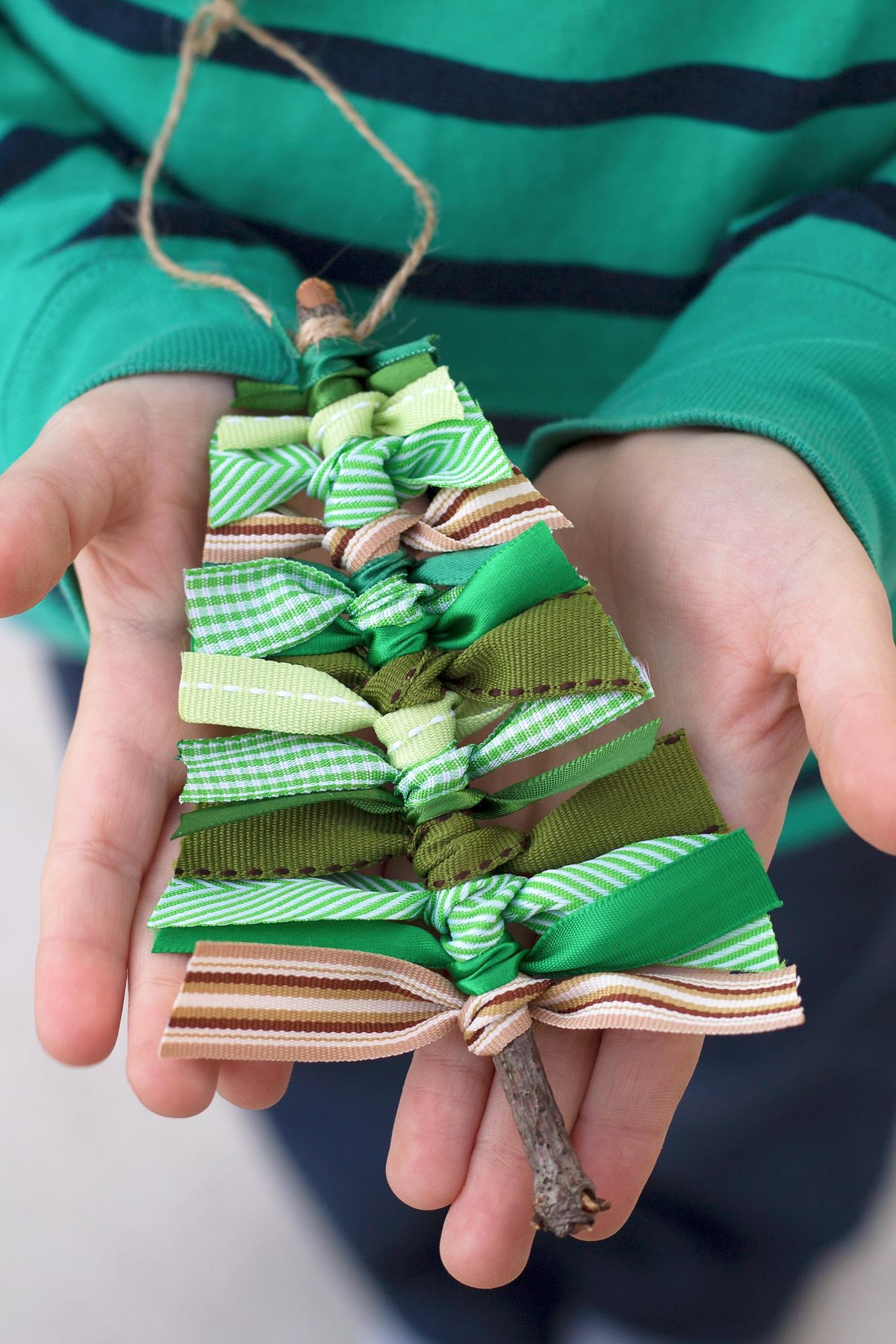 Child Holding Scrap Ribbon Christmas Tree Ornament