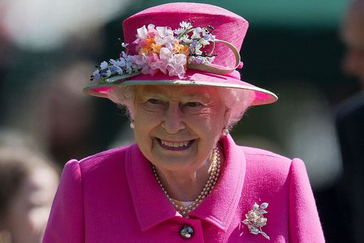 Britain's Queen Elizabeth II smiles as she leaves after attending the opening of a bandstand at Alexandra Gardens in Windsor, west of London, on April 20, 2016, the day before her 90th birthday. Queen Elizabeth II is set to celebrate her 90th birthday on April 21, with a family gathering and a cake baked by a reality television star, as a new poll finds Britain's longest serving monarch is as popular as ever. The queen has reigned for more than 63 years and shows no sign of retiring, even if she has in recent years passed on some of her duties to the younger royals. / AFP PHOTO / JUSTIN TALLIS