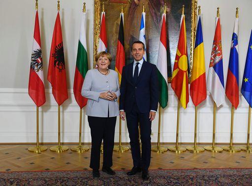 Angela Merkel (L) Austrian chancellor Christian Kern (R)