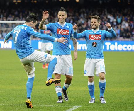 Napoli's José María Callejón, left, celebrates with teammates Marek Hamík, center, and Dries Mertens, after scoring during a Serie A soccer match between Napoli and Empoli, at the San Paolo stadium in Naples, Italy, Sunday, Jan. 31, 2016. (ANSA/AP Photo/Salvatore Laporta)
