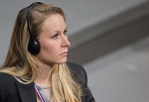 epa03550124 Grandaughter of the founder of the French Front Nationale Le Pen, Marion Marechal-Le Pen (FN), sits during a meeting of German and French parliamentarians at the German Bundestag in Berlin,†Germany, 22 January 2013. Celebrations are taking place for the 50th anniversary of the signing of the Elysee Treaty on 22 January 1963.  EPA/MICHAEL KAPPELER