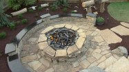 Pretty landscape with a stone fire pit