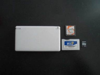 The Picture Above Shows DS Lite An M3 Adapter A Mini SD And PassMe Card Is Same Size As Game But Its Purpose