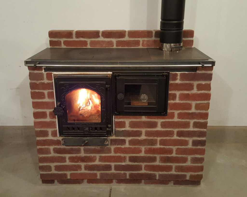 The Cabin Stove - a small masonry heater and cook stove combination.