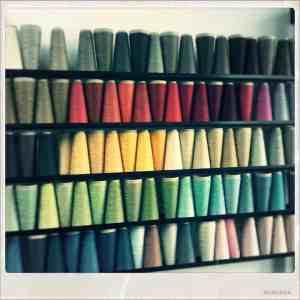 wall display of linen yarn cones