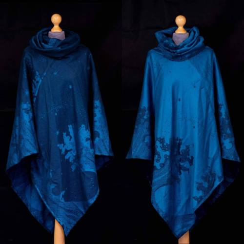 Teal and navy cotton and cashmere poncho with a design of crashing waves