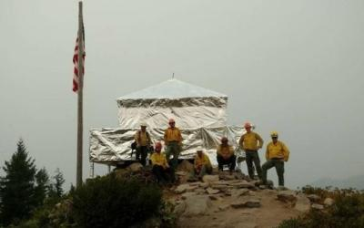 Historic lookout wrapped in fire-resistant material to save it from wildfire