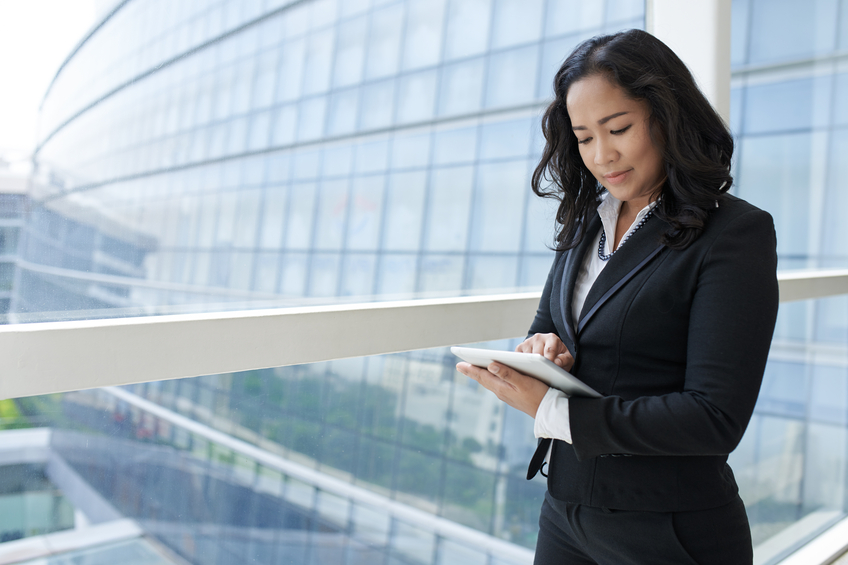 Portrait of Asian business lady using digital tablet