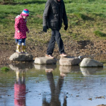 Grandfather and granddaughter enjoyinh Firs Farm Wetlands togehter