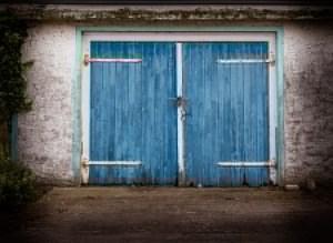 Tips for Maintaining Your Wood Garage Door