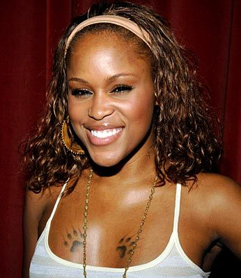 Rapper Eve's Chest Paw Tattoo: Celebrity Tattoos