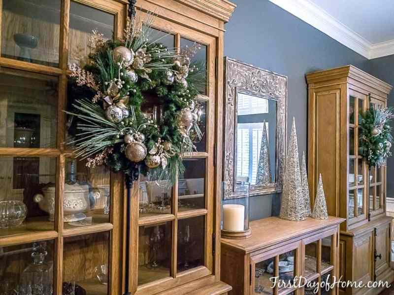 Homemade Christmas wreath hanging on cabinet