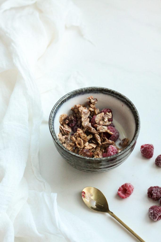 Home made banana and cinnamon grain free granola with frozen rasberries