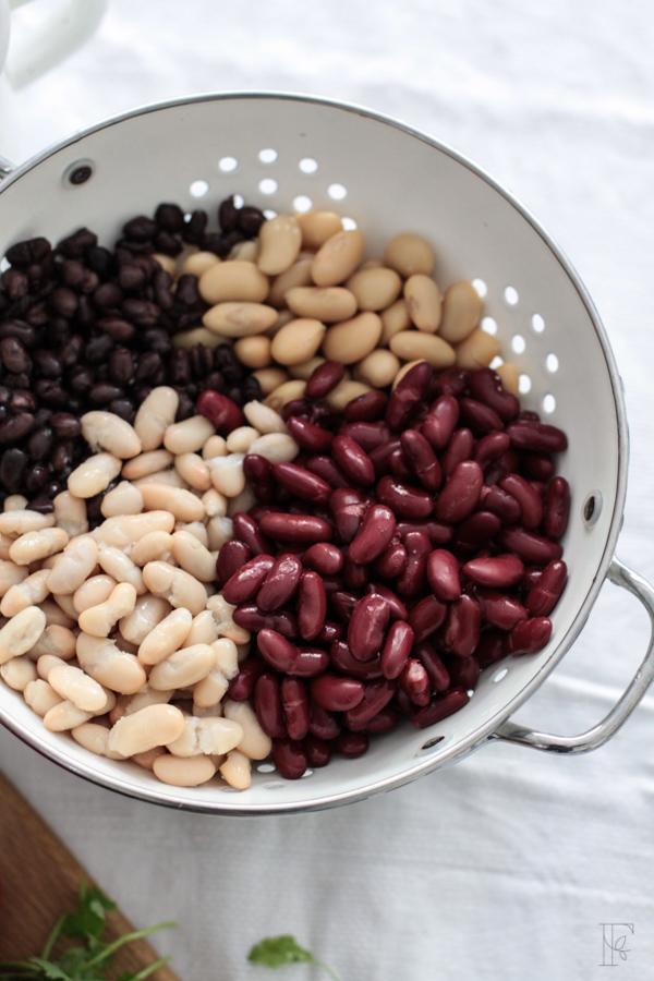Draining organic beans for a four bean salad