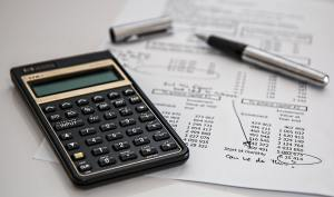 a financial report and a calculator