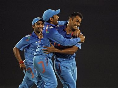 India's Stuart Binny, right, celebrates with teammates after taking the wicket of Bangladesh's Mahmudullah. AP