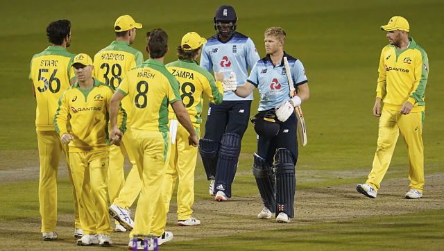 England batsmen Sam Billings, second right, and Jofra Archer, third right, greet Australian players at the end of the first ODI cricket match between England and Australia, at Old Trafford in Manchester, England, Friday, Sept. 11, 2020. (AP Photo/Jon Super, Pool)