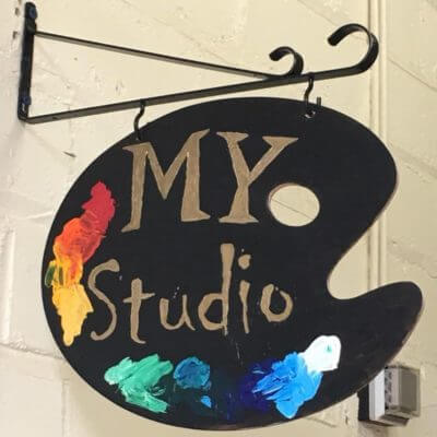 My Studio sign hanging outside the room