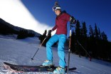 Anna Marie Migl, from Denver, steps into her bindings before taking a run on opening day of ski season at Arapahoe Basin Ski Area Friday, Oct. 21, 2016 (photo: Jack Dempsey)