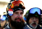 """Cam Shaw from Frisco, Colo., wears an """"I Skied Opening Day 2016"""" pin on the opening day of ski season at Arapahoe Basin Ski Area Friday, Oct. 21, 2016. (photo: Jack Dempsey)"""