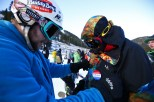 """Dan Muehlfelt, left, pins the """"I Skied Opening Day 2016"""" on his brother Frank from Chicago on the opening day of ski season at Arapahoe Basin Ski Area Friday, Oct. 21, 2016. (photo: Jack Dempsey)"""