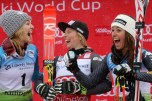 Nina Loeseth (NOR) in second place, Tessa Worley (FRA) in first place and Sofia Goggia (ITA) third place share a laugh on the podium at the conclusion of the Audi FIS Ski World Cup Giant Slalom at Killington in central Vermont. (FTO photo: Martin Griff)