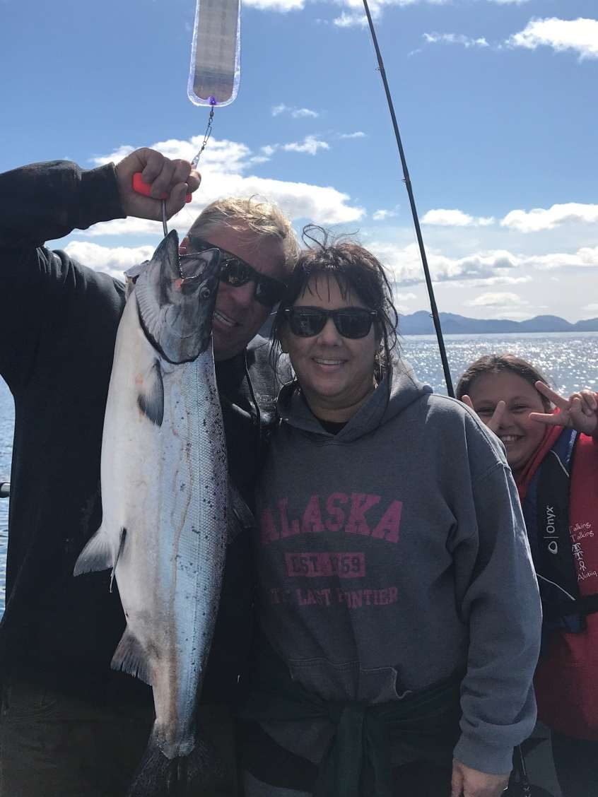 Capt. Dave & Laurie holding a King Salmon caught on Fish N' Chips Charters Kodiak Island Alaska