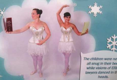Close-up of Holiday Cards featuring two Attorneys dressed up as Ballerinas