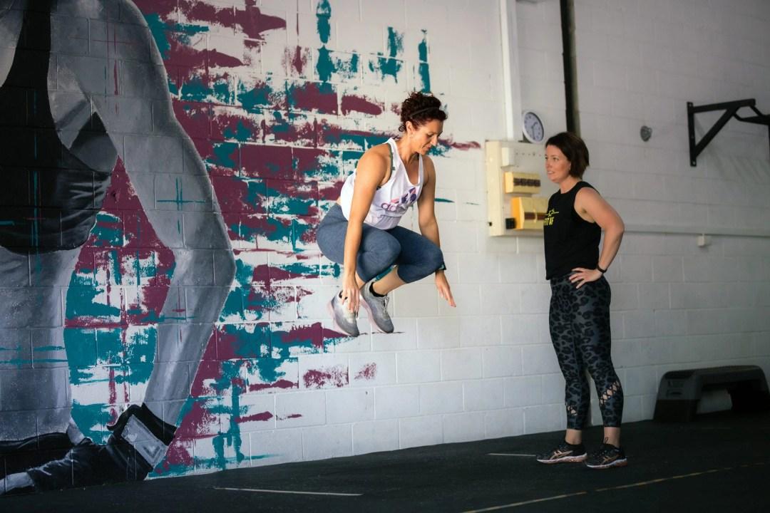 Coach Angie coaching tuck jumps