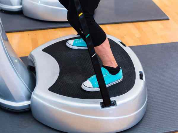Woman plates in gym doing fitness exercise