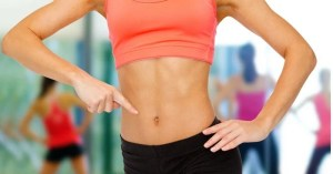 woman pointing at toned abs