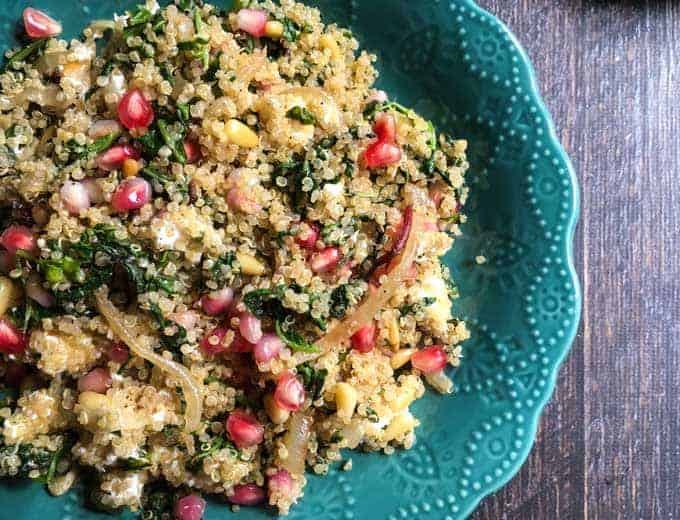 quinoa pilaf with colorful pomegranate and kale