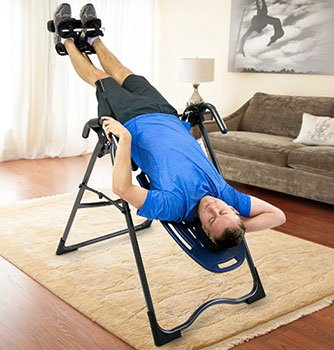 Man Using Inversion Table At Home