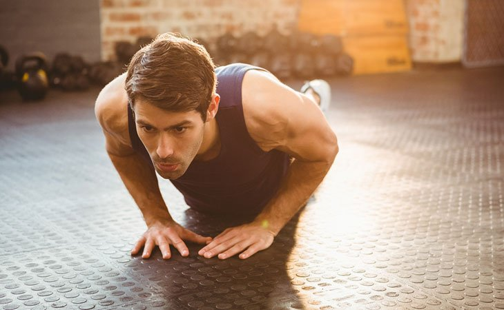 Man Doing A Cross Push Up For Chest