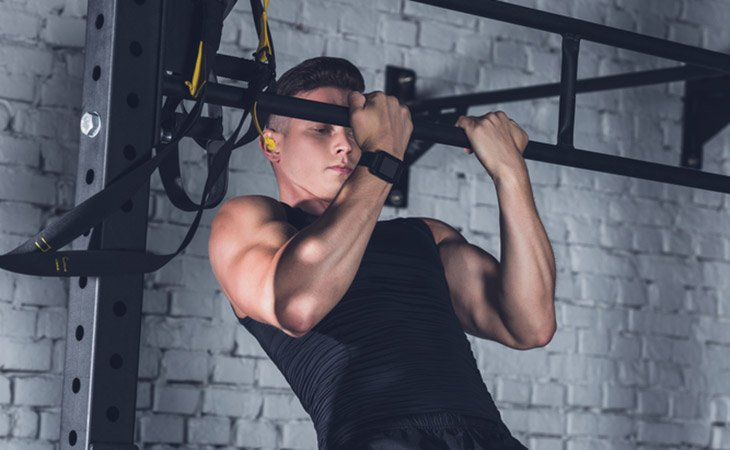 Fit Man Doing Chin Up Exercise For Biceps