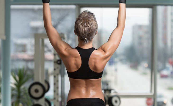 Woman Starting To Work Out Back For Fitness