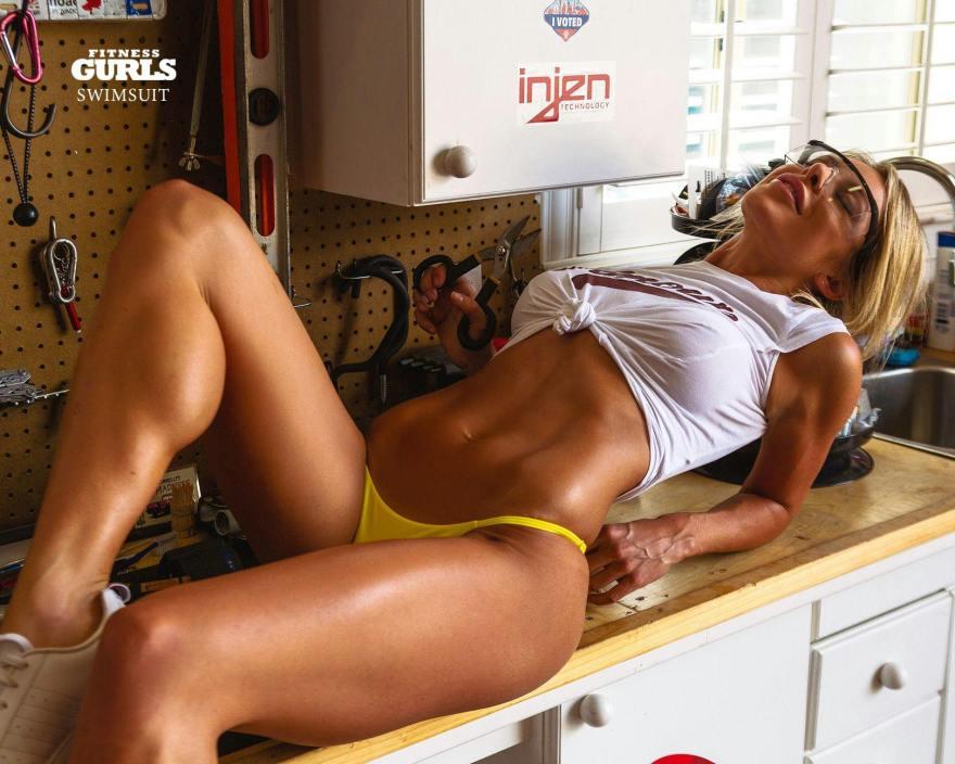 Savannah Lynx on a shop bench in Fitness Gurls Swimsuit 2020