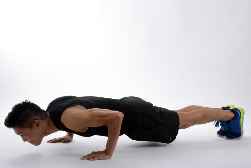 young man doing  incline push-up at home