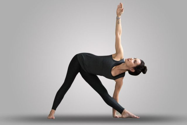 Extended-triangle-pose-Yoga for Tinnitus