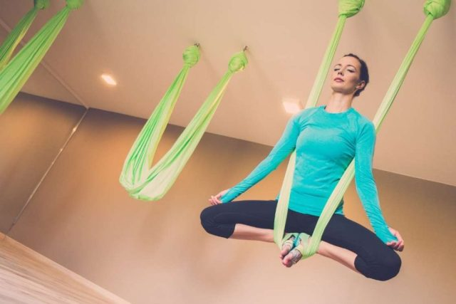 Aerial butterfly pose for height increase