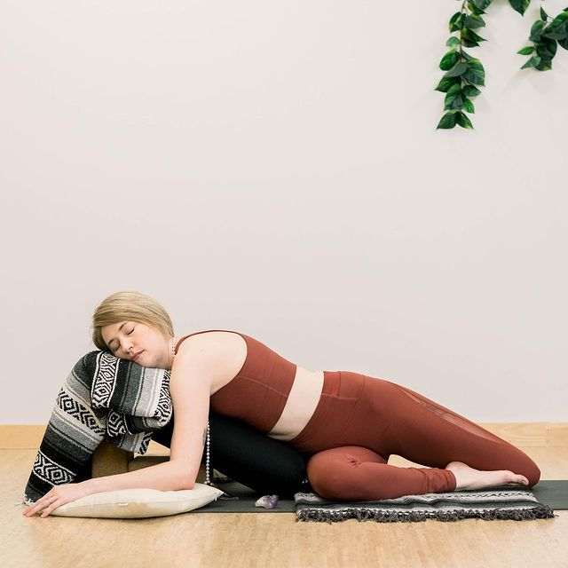 Reclining Twist with a Bolster (Supported Bharadvaja Twist Pose) - Fitzabout