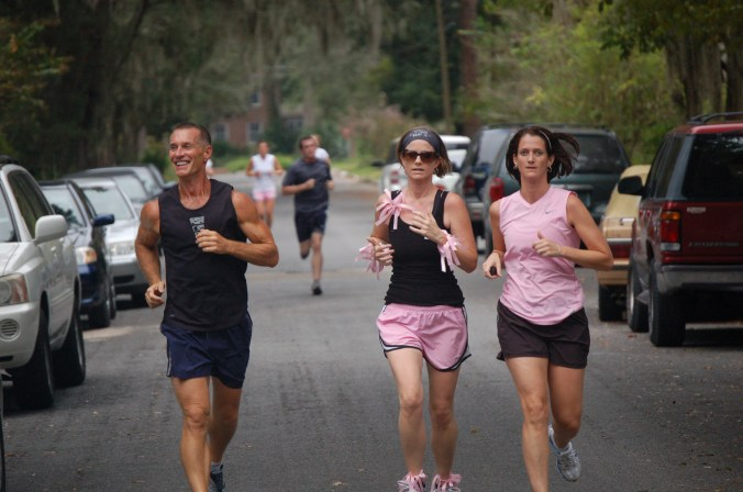 Jacki Donaldson (center) runs with her dad (left) and sister (right) in the October 2009 Making Strides Against Breast Cancer 5K in Gainesvlle, Fla.